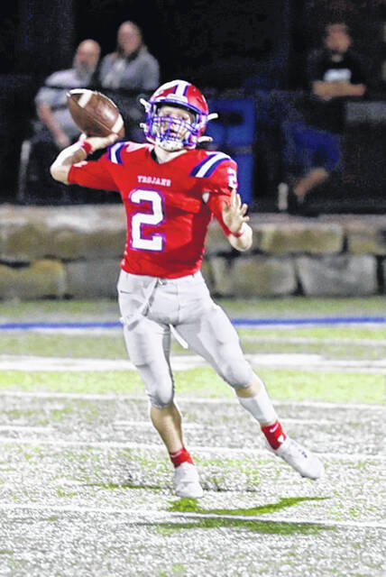 Portsmouth quarterback Drew Roe (2) leads the undefeated in the Ohio Valley Conference Trojans against Fairland for Friday night's key OVC football game at Jim Mayo Memorial Stadium.