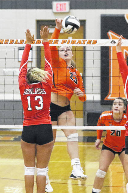 Wheelersburg senior middle blocker Ryleigh Meeker goes up for a kill during the Pirates' non-league volleyball match against Jackson earlier this season.