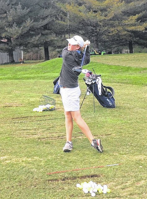 Valley freshman Cameron Phillips practices on Tuesday at The Elks Country Club driving range as part of his preparation for Friday and Saturday's state boys golf Division III championship rounds.