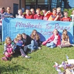 Park Ave. school students plant Pinwheels for Peace
