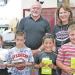 Rotary gifts Cardington third graders with dictionaries