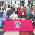 Cardington football players sign to compete in college