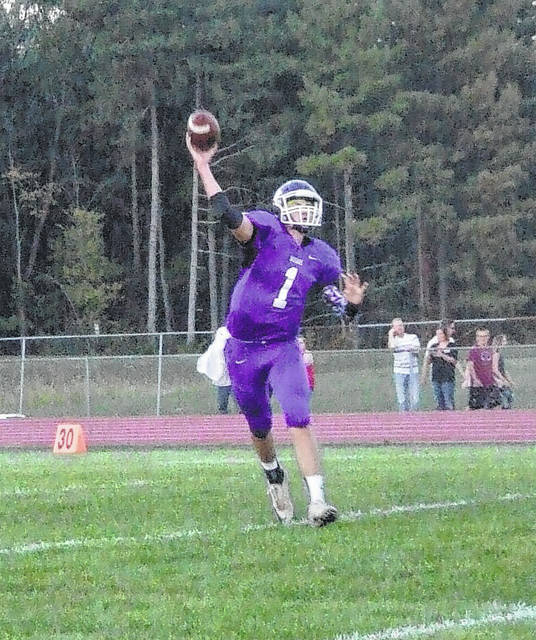 Seth Young prepares to unleash a pass in Mount Gilead's home football contest with Fredericktown.