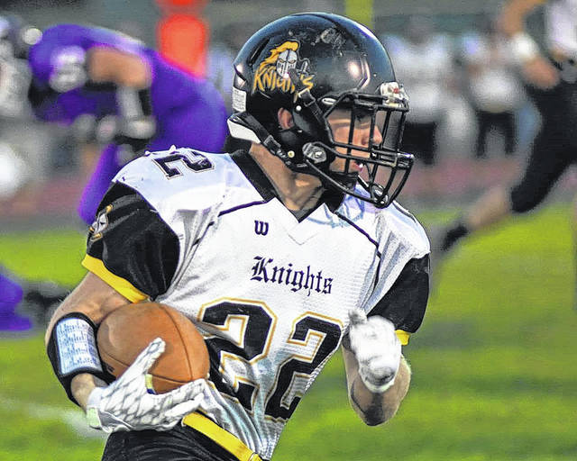 Northmor's Conan Becker runs for yardage against Mount Gilead Friday night. Becker helped the Golden Knights secure a 54-26 victory.