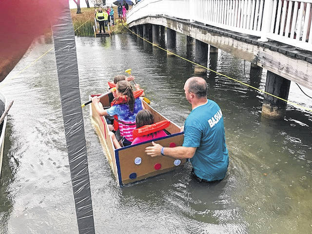 Highland Elementary School held the third annual fifth grade cardboard boat challenge Oct. 5. Despite rain, the student designed a boat out of only cardboard and duck tape that would take them across the pond. Students worked in math, science, social studies and reading to learn about what design ideas would be good for their boat.