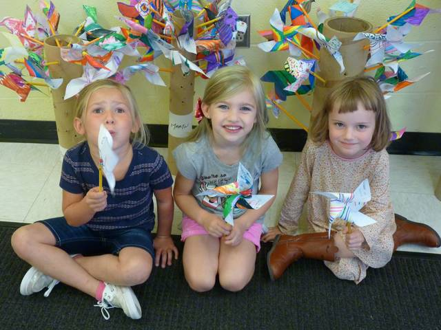These Park Avenue Elementary students planted their Pin Wheels for Peace when the day was observed world wide. Students in Kim Porter's class are, from left, Jillian Laroche, Paisley Douglas and Miriam Sipple.