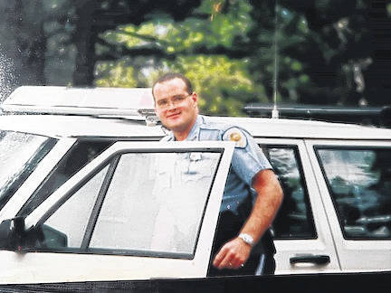 Deputy Brent Holloway enters his deputy sheriff's vehicle in Colorado. Holloway was killed in the line of duty on Oct. 16, 1995.