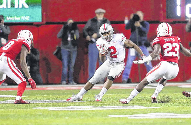 Don Speck | Aim Media Ohio State freshman running back J.K. Dobbins makes a cut on a carry against Nebraska earlier this season.