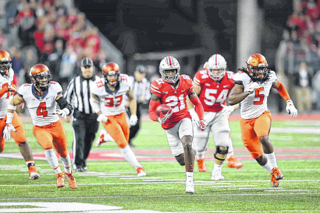 Ohio State #21 wide receiver Paris Campbell heads up field for a big gain in the first quarter as several members of the Illinois defense trail on the play at Ohio Stadium on the campus of The Ohio State University  November 18, 2017 Photos by Don Speck
