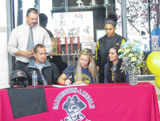 Cardington senior Brooklyn Whitt signs her letter of intent to play softball for Kent State University. Sitting with her are parents Patrick and Angie. In the back row are Cardington head softball coach Tod Brininger and Micaela Minner, former member of the Akron Racers who has been Whitt's hitting coach.