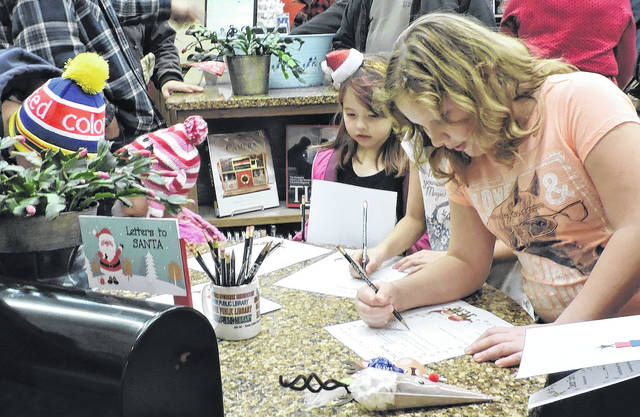 Children wrote letters to Santa at Selover Library's open house.