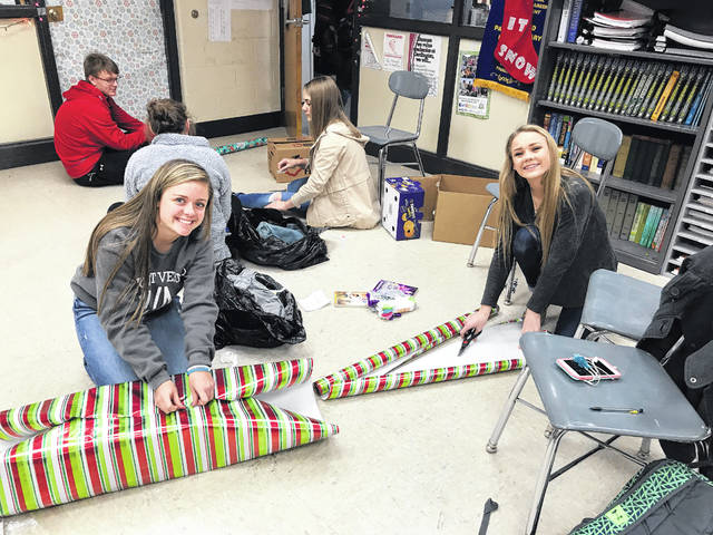 Emily Pearl and Maddie Sites, Cardington FFA members wrap gifts for the chapter's Adopt a Family program.