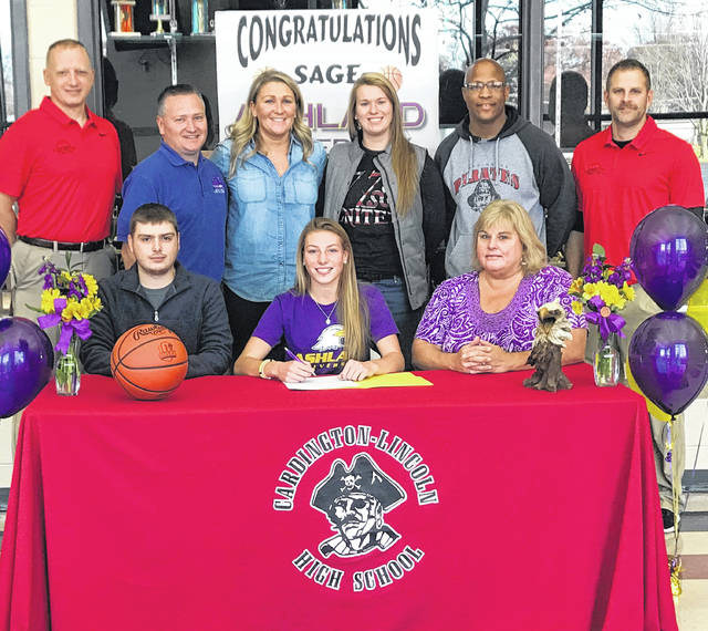 Pictured above is Cardington senior Sage Brannon signing to play college basketball for Ashland University. In the front row with her are her mother, Carol, and brother, Cade. In the back row are (l-r): Scott Hardwick, Tim Maceyko, Jodi Brown, Megan King, Chuck Jones and Jamie Edwards. Edwards and Hardwick are the current high school coaches, Brown coached Brannon as a freshman, King was her AAU coach for three years and both Maceyko and Jones coached her in youth and junior high.