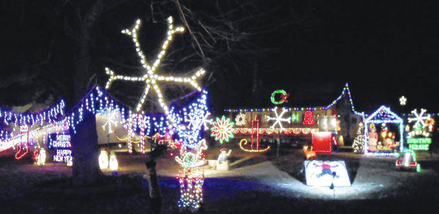 The Christmas light display is by Shank's Auto Service on State Route 19 in North Bloomfield. The snow angel, bear and Ferris wheel all have animation.