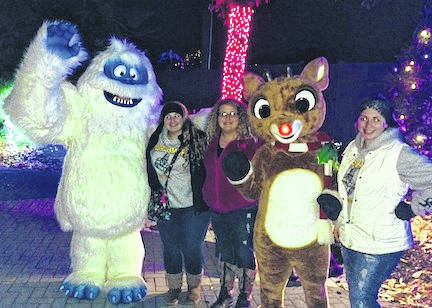Mr. Bumble and Rudolph are pictured with Jobs for Ohio Grads students Alee Ivy, Alexis Yarnell and Haylee Humphrey seeing the Wildlights at the Columbus Zoo during a recent trip.
