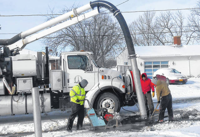 Mount Gilead Water Department crew were out in 15 degrees repairing the water main on Hickory Lane. They include Kit St. Clair, Brandon McCunn and Frank Foltz.