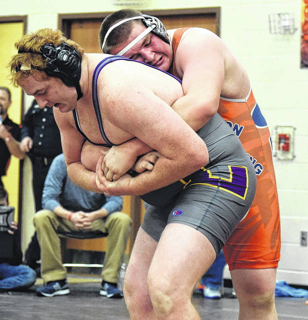 Galion's 285-pounder Mason Weldon hangs onto Lexington heavyweight A.J. Adams. on Saturday evening. Weldon won the match, 8-2, and finished third in his weight class.