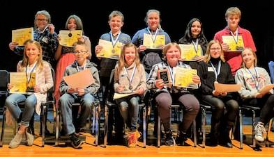 The twelve spellers to qualify for the Tri-County Spelling Bee are in back from left: Ciara Giamarco, Ashlyn Troyer, Jake Law, Maleigha Holtrey, Terra Dean and Nathaniel Rutan. In front from left are: Camryn Miller, Malin Fichtner, Champion Jayci Black, First Runner-up Caitlyn Thieret, Piper Stepp and Megan Moller.