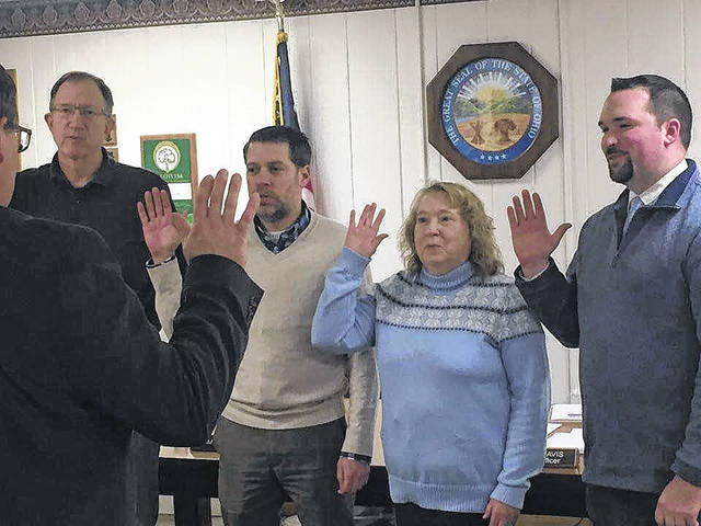 Mount Gilead Village Council members take their oath Jan. 2. They are, from left, Tim Clapper, Aron Fraizer, Kay Hines and new member Jamie Brucker. Morrow County Court of Common Pleas Judge Tom Elkin administers the oath.