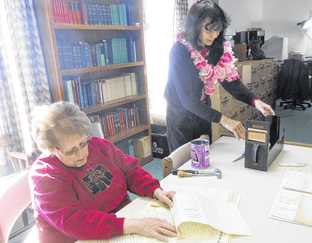 Volunteers at the Mount Gilead Public Library Annex work to prepare court documents for Family Search.