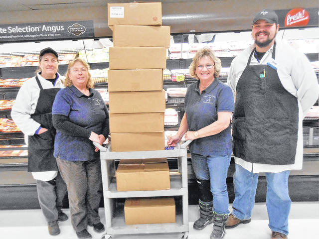 Shown, from left, are Dee Hoffman of the Kroger meat department, Teresa Shipman and Brenda Harden of the Morrow County Food Pantry and Mount Gilead Kroger's head meat cutter, Caleb Fissel, with hams, which will be at the Food Pantry through January. Food Pantry Director Russ Merrin is absent from the photo.