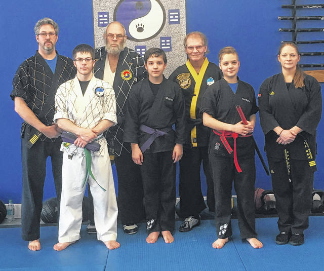 Wolfpak Martial Arts recently promoted three students. Pictured are, in the back row (l-r): Master Sam Wolf, Master Tom Wolf, instructor Larry Foster and instructor Tisha Bivens. Front row: Justin Burkey, Hunter Berthold and Caitlyn Berthold.