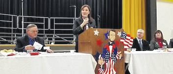 Mary Taylor, candidate for Governor of Ohio, speaking at the Lincoln Day Dinner at Northmor High School. From left are Dan Osborn, Taylor, Jeff Bood and Morrow County Auditor Patricia Davies.