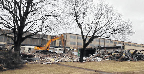 After a fire severely damaged the front and offices of the HPM building, the village fire department required that the front section be demolished and hauled away. Workers at the site said that GMC Excavation and Trucking LTD will be taking all the material except for the steel to a waste site in Crawford County. Steel Valley Construction of Youngstown is doing the demolition work.