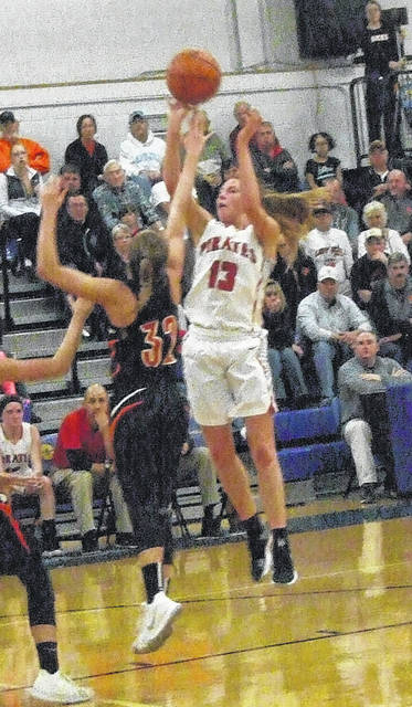 Sage Brannon goes up for a shot against Amanda-Clearcreek Tuesday.