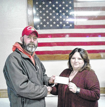 Richard Braddock, senior vice commander of VFW Post 8054, handing donation of $2,000 to Sandy Williamson of Morrow County Humane Society.
