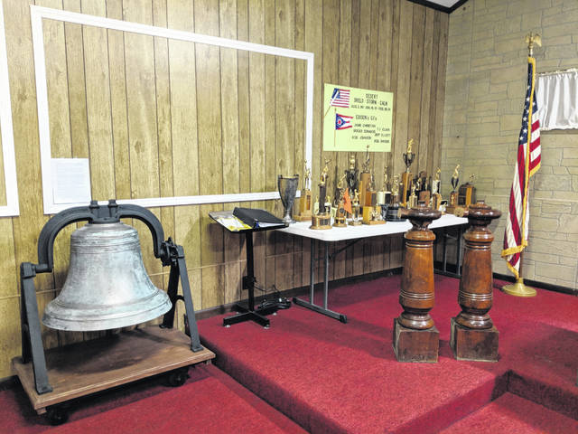 "Two banisters from Edison School were ""rescued"" by Karon (Salisbury) Ridenour as the building was demolished. They are on display at the Edison Municipal Building with trophies and the school bell."