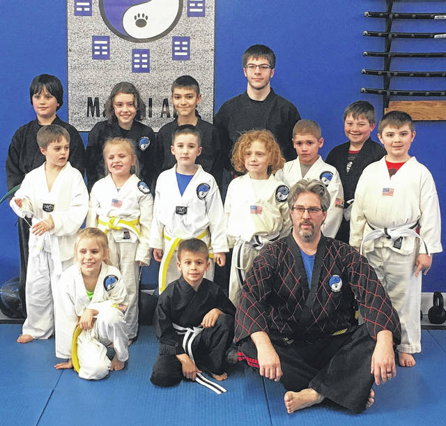 Wolfpak promoted their Timberwolf class on March 15. In the back row are (l-r): Justin Berthold, Aria Wright, Colton Peters, assistant instructor Justin Burkey and Quillan Rocks. Middle row: Justin Bowersmith, Channing Redman, Jase Barlow, Ian Furr, Brycen Gaberial and Landin Holt. Front row: Chessa Redman, Gavin Smith and Master Sam Wolf. Not shown are Braylin Romshak and Cohan Hurst.