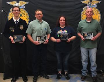 These individuals were made FFA honorary members during the FFA banquet because of their contributions to the local chapter, from left, Jeff Stimmell, John Hall, Heather Langet and Steve Fissell.