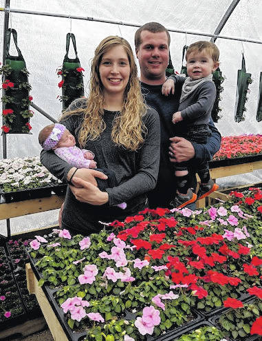 New owners and operators of Pleasant View Greenhouse are Kelsey and Jaren Jesson, with their children Lydia and Gavin. Previous owners were Peggy and Jonathan Bosh.