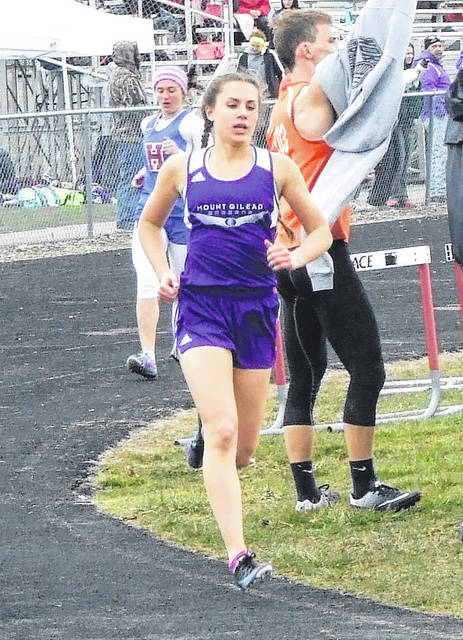 Mount Gilead's Baylee Hack leads Alex Debord of Highland on her way to winning the 1600 Saturday at the Mike Armstrong Invitational hosted by Cardington.