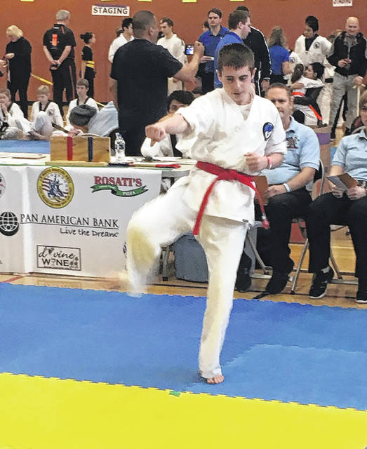 The Wolfpak competition team sent Master Sam Wolf (coach) and Logan Welsh (pictured) to coach and compete at the annual Moo Do Won international Samurang games martial arts festival and championships in Chicago. Welsh brought home two first-place awards, as well as two seconds and three thirds.