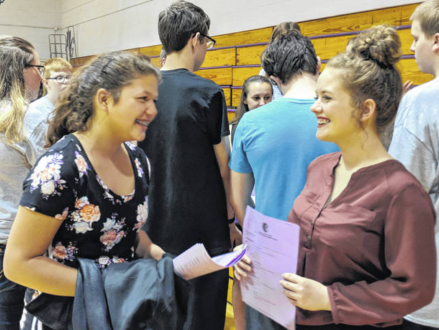 Eighth grade student Anna Marocco left, visits with freshman Riley Saylor after the school board meeting. Both hope that Mount Gilead's financial problems can be resolved so they can take Advanced Placement classes.