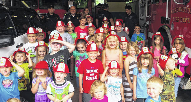 Children enjoy the Community Heroes Summer Reading Program at the Cardington Fire House.