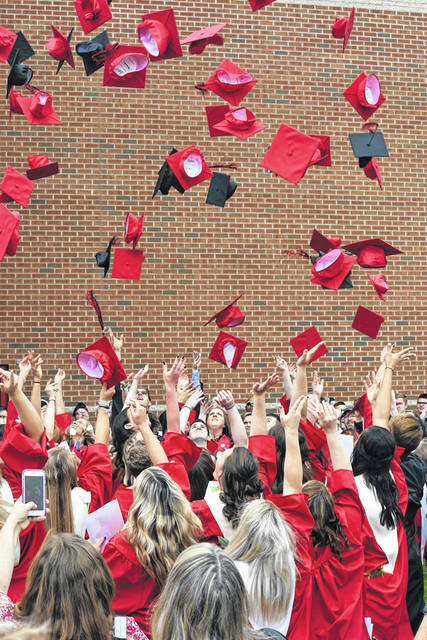 Cardington-Lincoln High School students throw their caps in the air Sunday, May 20 after commencement exercises. More photos online at www.morrowcountysentinel.com and look for a special section next month saluting all Morrow County 2018 graduates.