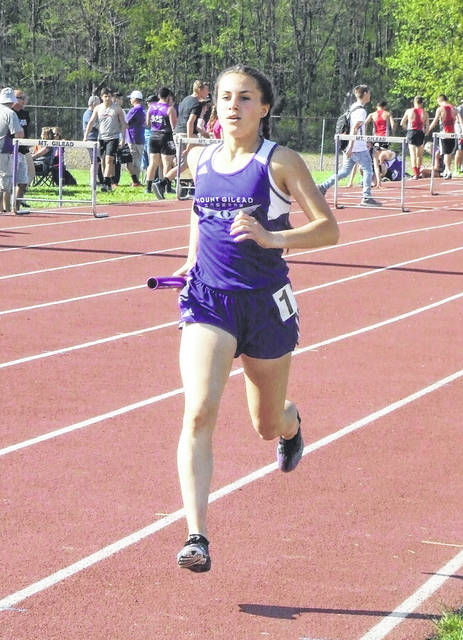 Baylee Hack runs in the 3200-meter relay for Mount Gilead. The Lady Indians won in that event on their way to taking a commanding lead in the KMAC track championships after the first day of the meet.