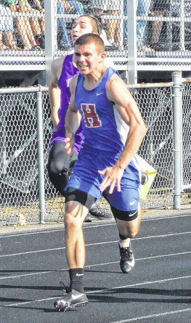 Highland's Brock Veley sprints to the finish line in qualifying for the finals in the 100-meter dash at regionals.