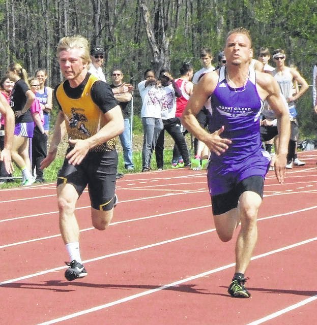 Northmor's Conan Becker (l) and Mount Gilead's Dorian James battle for position in a preliminary heat of the 100-meter dash Saturday. Becker would finish second in the event, while James took sixth.