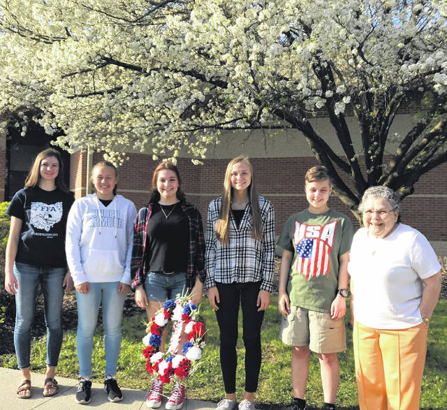 Pictured with Shirley Dendinger, right, who made the wreath placed on the Vietnam Wall during the Cardington-Lincoln eighth grade trip to Washington, D.C. is pictured with the eighth grade girls who placed the wreath on the Vietnam Wall and then the World War II Memorial are, from left, Elizabeth Hardwick, Shaylynn Morris-Montgomery, Brooklynn Clapham, Dana Bertke and Caitlynn Berthold.