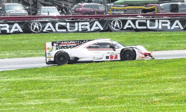 The duo of Ricky Taylor and Helio Castroneves claimed first place overall in Sunday's Mid-Ohio Sports Car Showdown.