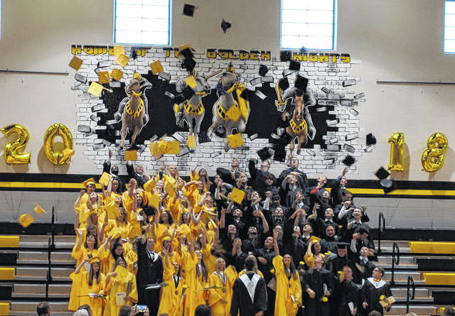 Northmor High School graduates throw their caps in the air on Sunday afternoon. More photos online at www.morrowcountysentinel.com and look for a special section June 20 saluting all Morrow County 2018 graduates.
