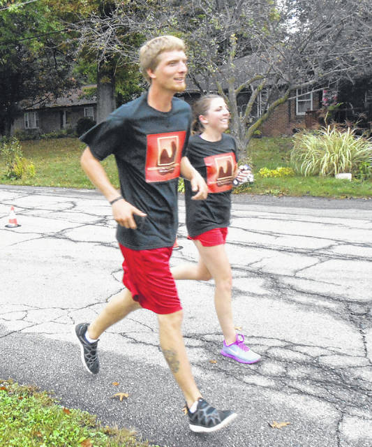 Runners from Morrow Dental finish a past Community Center 5K with a smile.