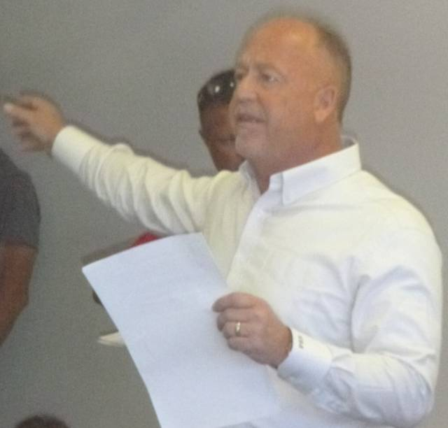Realtor Craig Miley conducts an auction last Thursday at the former Save-A-Lot grocery at 133 Iberia St., Mount Gilead. It sold for $330,000.