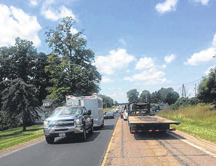 Crews from ODOT work on State Route 95 near I-71 east Thursday afternoon doing paving. Work is expected to be completed in the next couple of weeks.