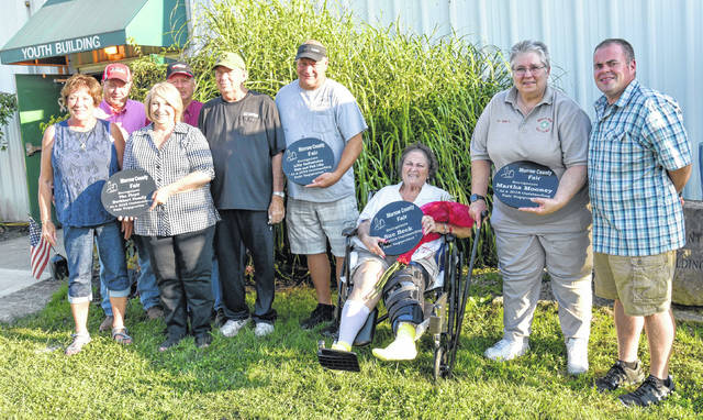 These people were honored for their dedication to the Morrow County Fair when Morrow County Fair Board president Brandon Strain acknowledged them Tuesday evening, Aug. 28. From left: Ronnie and Chuck Burkhart; Dale and Phil Lily; Sue Beck, Dr. Martha Mooney and Brandon Strain.