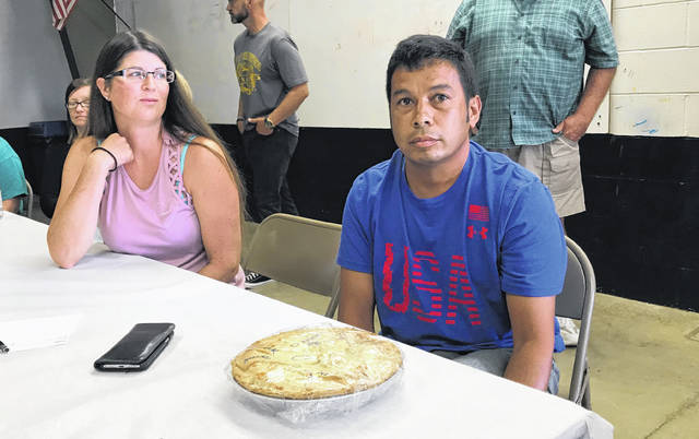 Courtesy Photo Karen and Louie Cortez purchased a pie made in honor of Colby Hildreth at the annual Northmor pie auction. The pie was made by Cake and Icing in Galion.
